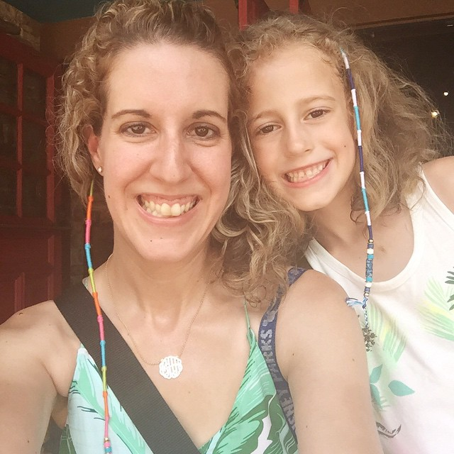 We decided to get hair wraps for fun. I got a rainbow 💙💛💜❤️💚 one and Autumn got a Frozen💙❄️ colored one. So fun! Except my hair is a hot mess in this Florida humidity! 😁 #hair