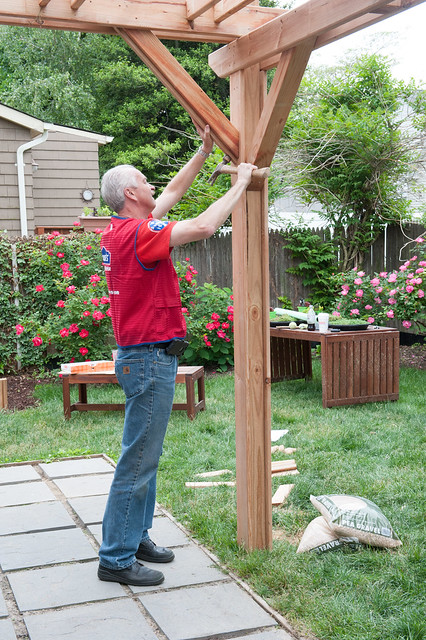 Lowe's Volunteer helping to build the outdoor living room pergola