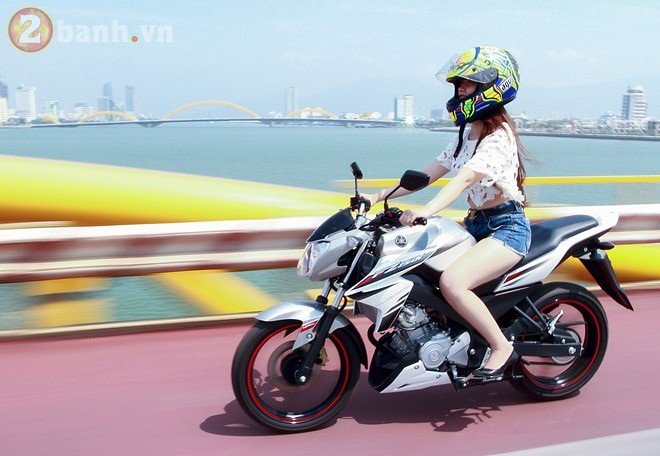 Sexy vietnam girl in high heels on a naked Yamaha Exciter