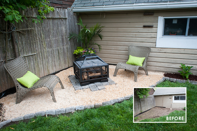 pea gravel fire pit area edged with pavers with two chairs on the back right corner of the yard next to their shed