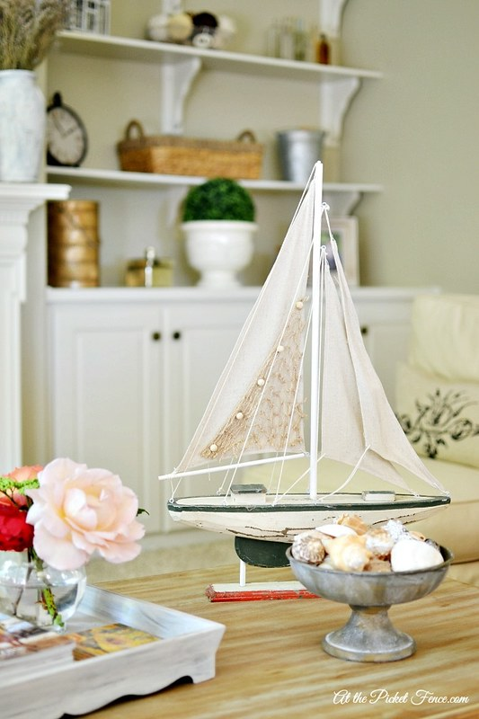 wood-sailboat-on-coffee-table-