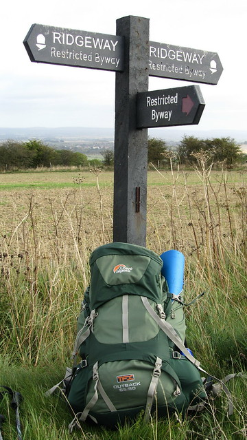 Sign post and rucksack