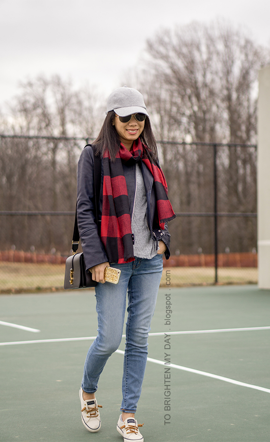 gray baseball cap, red buffalo check scarf, black leather jacket, gray tee, lightwash jeans black shoulder bag, canvas sneakers