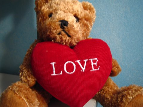 Teddy Bear Holding A Heart Coloring Page