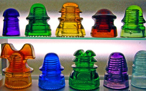 telephone pole insulators part of a colorful collection