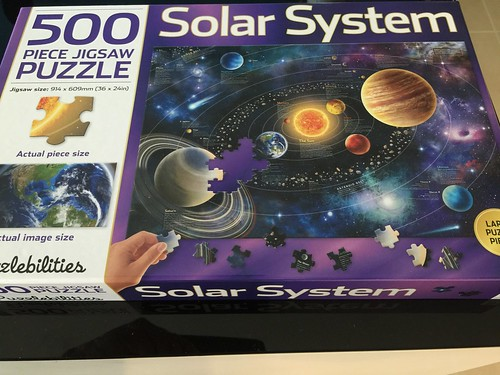 Family time... Working on the solar system jigsaw puzzle.