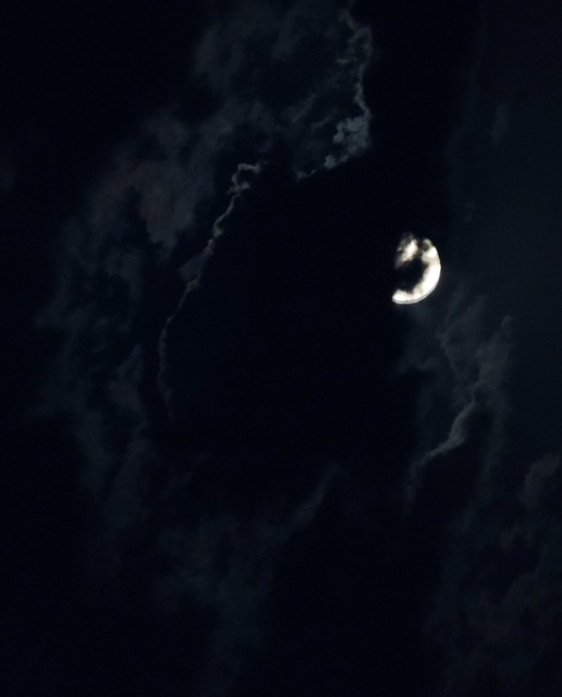 Moon behind storm clouds