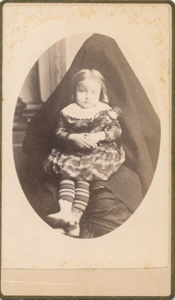 Little Girl With Her Doll And Hidden Mother