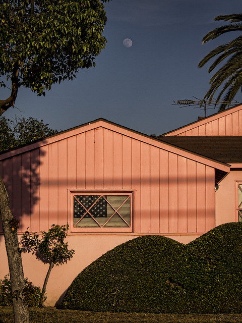 Pink house and faded flag