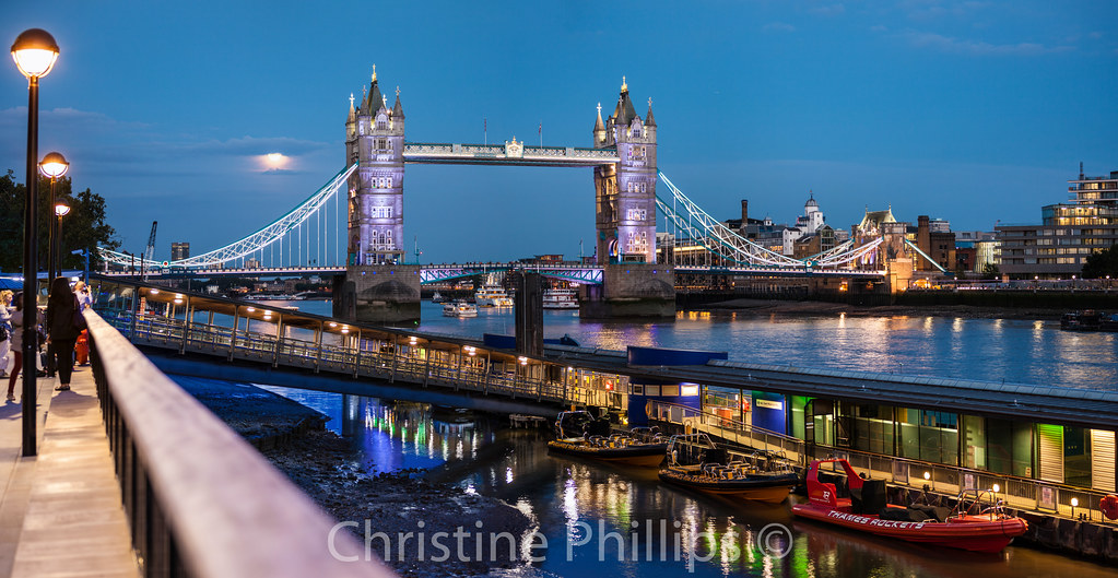 Tower bridge and the full moon in london a familiar for Design agency london bridge