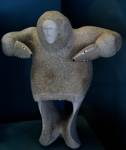 Whale bone carved figure the hands shaped as arctic fox h