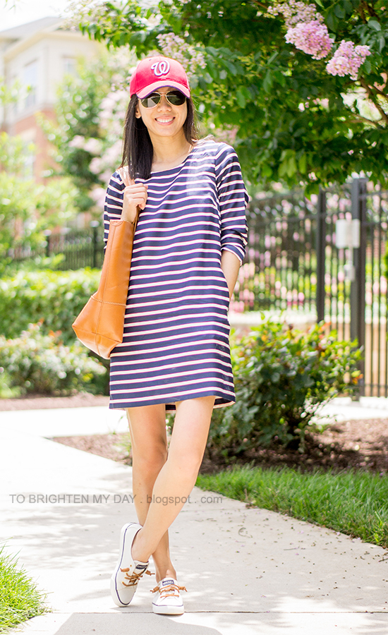 red cap, striped dress, cognac brown tote, boat shoes