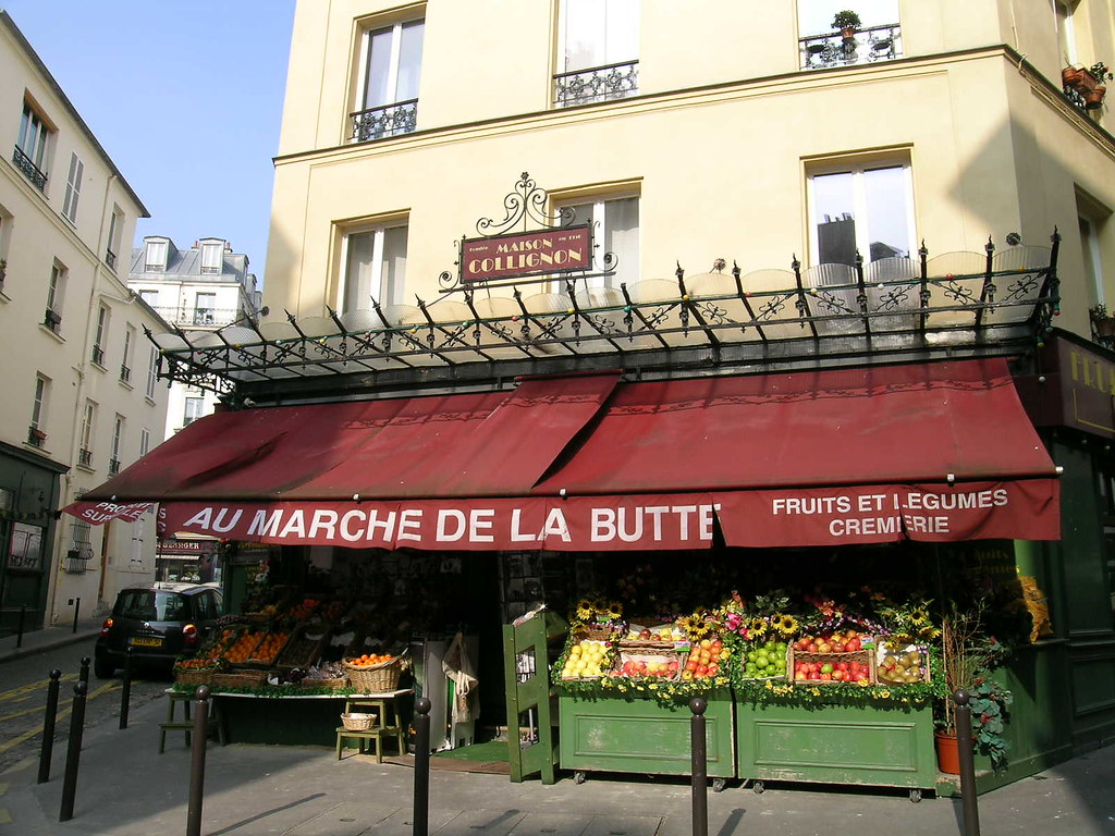 Au march de la butte paris france in the foodsteps of flickr - Marche au puce paris vetement ...
