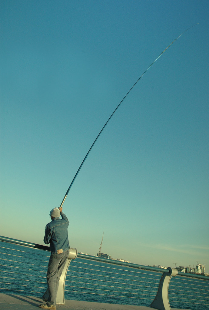 World 39 s longest fishing pole in action a man makes use for World of fishing
