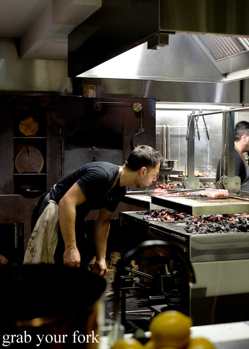 Chef Lennox Hastie stoking the woodfired grill at Firedoor, Surry Hills