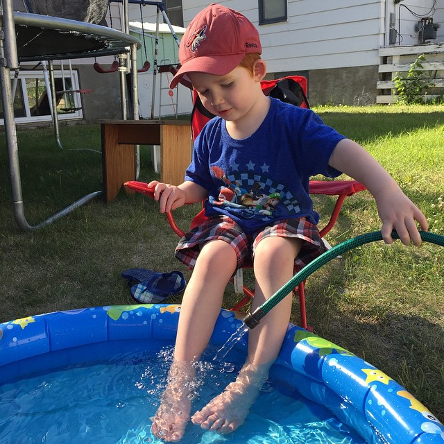 Cooling off in our pool. Our baby pool.