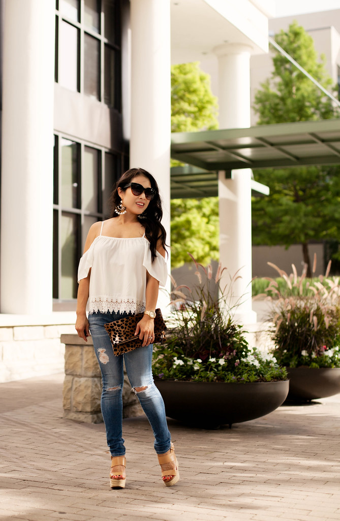 cute & little blog | petite fashion | white off shoulder lace blouse, distressed jeans, nude wedges, clare v leopard clutch, j.crew tortoise flower chandelier earrings | summer outfit