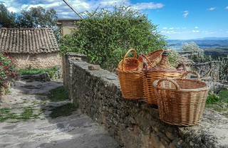 Four little baskets sitting on a wall | by eltpics