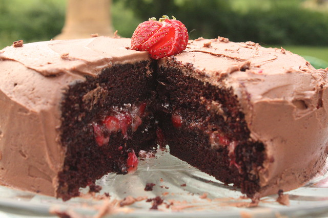 chocolate cake, chocolate frosting, strawberry middle
