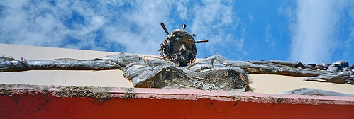 Looking up at a Christ sculpture on a building in Zacatecas, Mexico