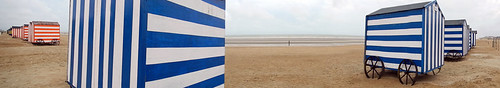 Blue striped bathing huts on the beach at Knokke Heist on Belgium's coast