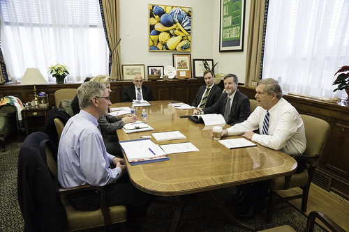 Agriculture Secretary Tom Vilsack and members of the United States Department of Agriculture's (USDA) Advisory Committee on Biotechnology and 21st Century Agriculture (AC21)