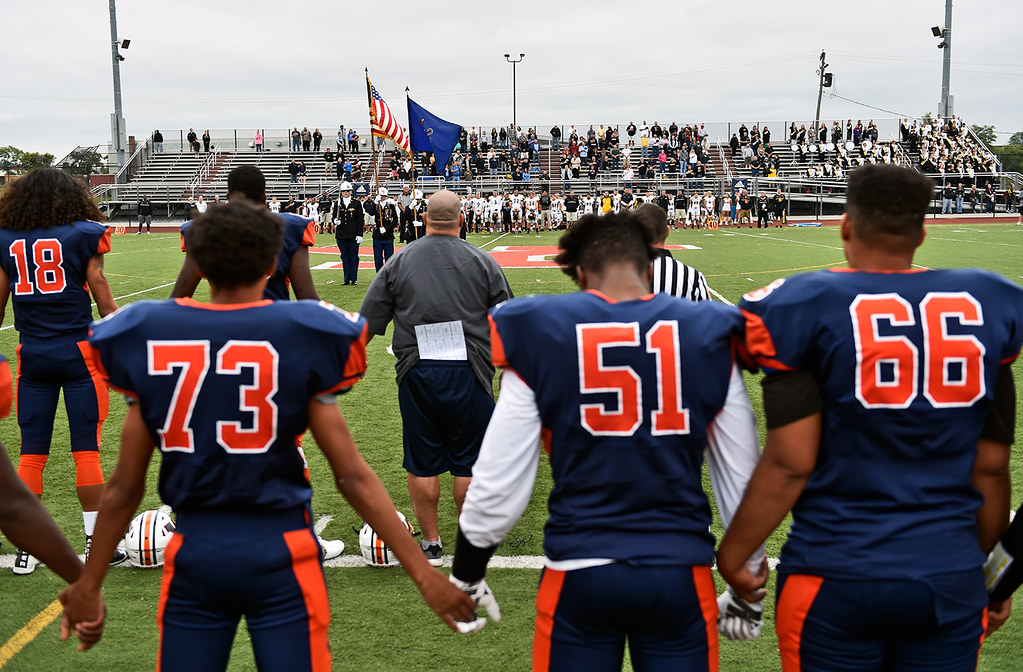 © 2016 by The York Daily Record/Sunday News. William Penn football players hold hands during the national anthem before a YAIAA football game Saturday, Sept. 24, 2016, at Small Field in York.