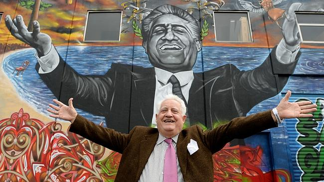 Franco Cozzo poses with mural, May 2015 (Maribyrnong Leader)