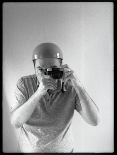 reflected self-portrait with Olympus Pen-D camera and Valencian hat