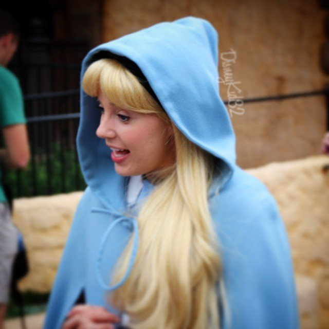 gingersnap alice looks adorable wearing a hooded cape to k