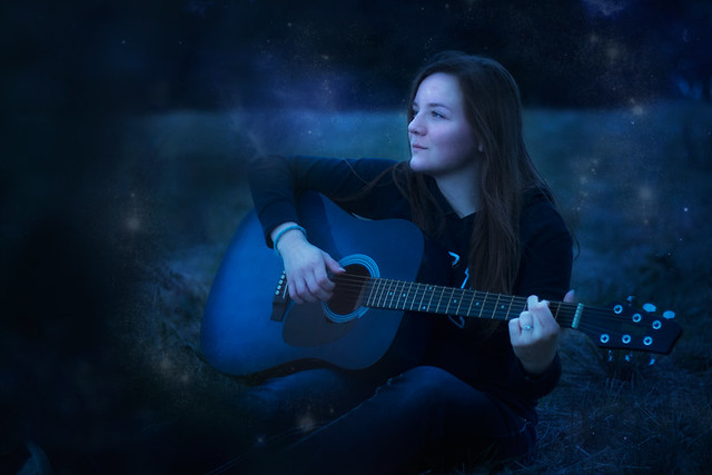 guitar player at night