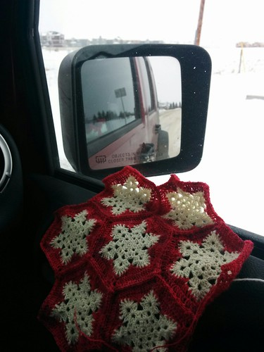 snowflakes on a snowy road