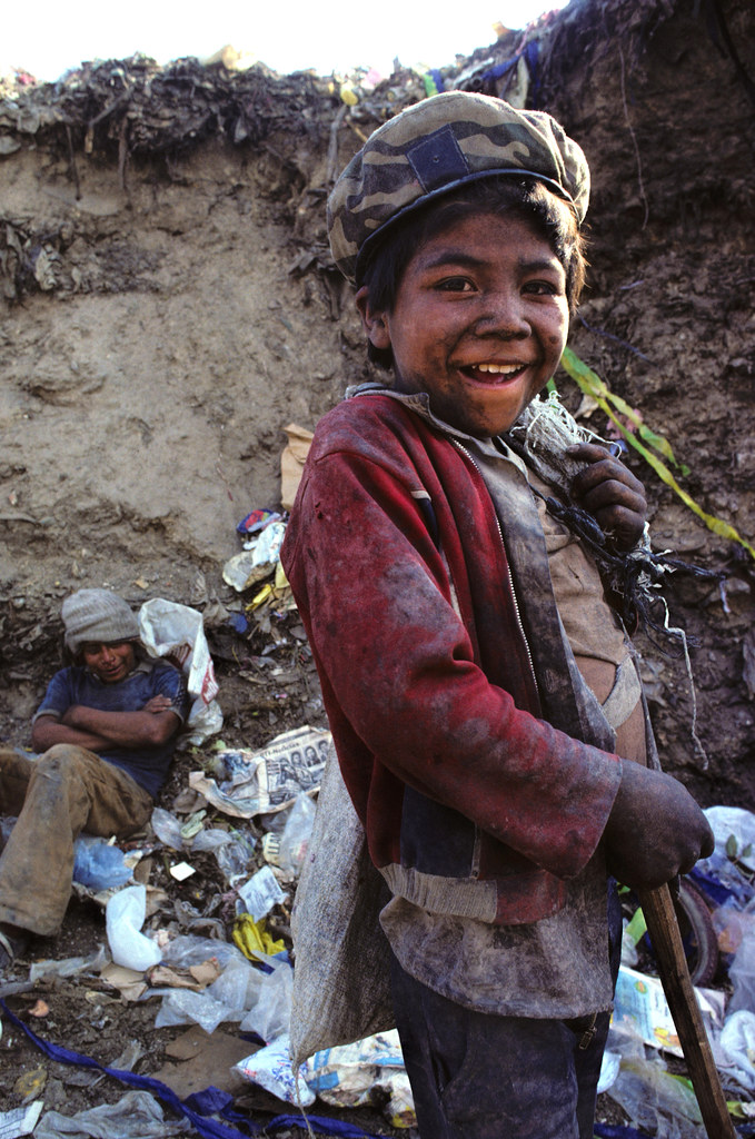 Scavenging at the dump, Guatemala, 1985 | by Marcelo  Montecino