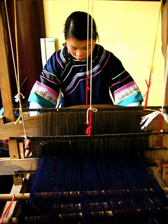 Working the loom at Black Dragon Pool Park, Lijiang | by Alexandra Moss