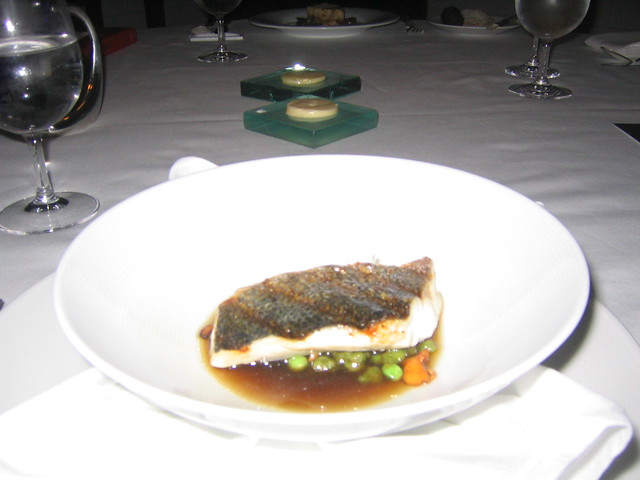 : Grilled Loup de Mer, Hudson Valley foie gras consomme. English pea ...