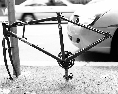 Bike frame locked to a pole | by Justin Mclean