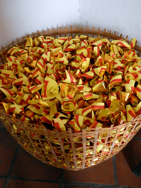 Paper wishes in a basket in a Chinese temple in Penang, Malaysia