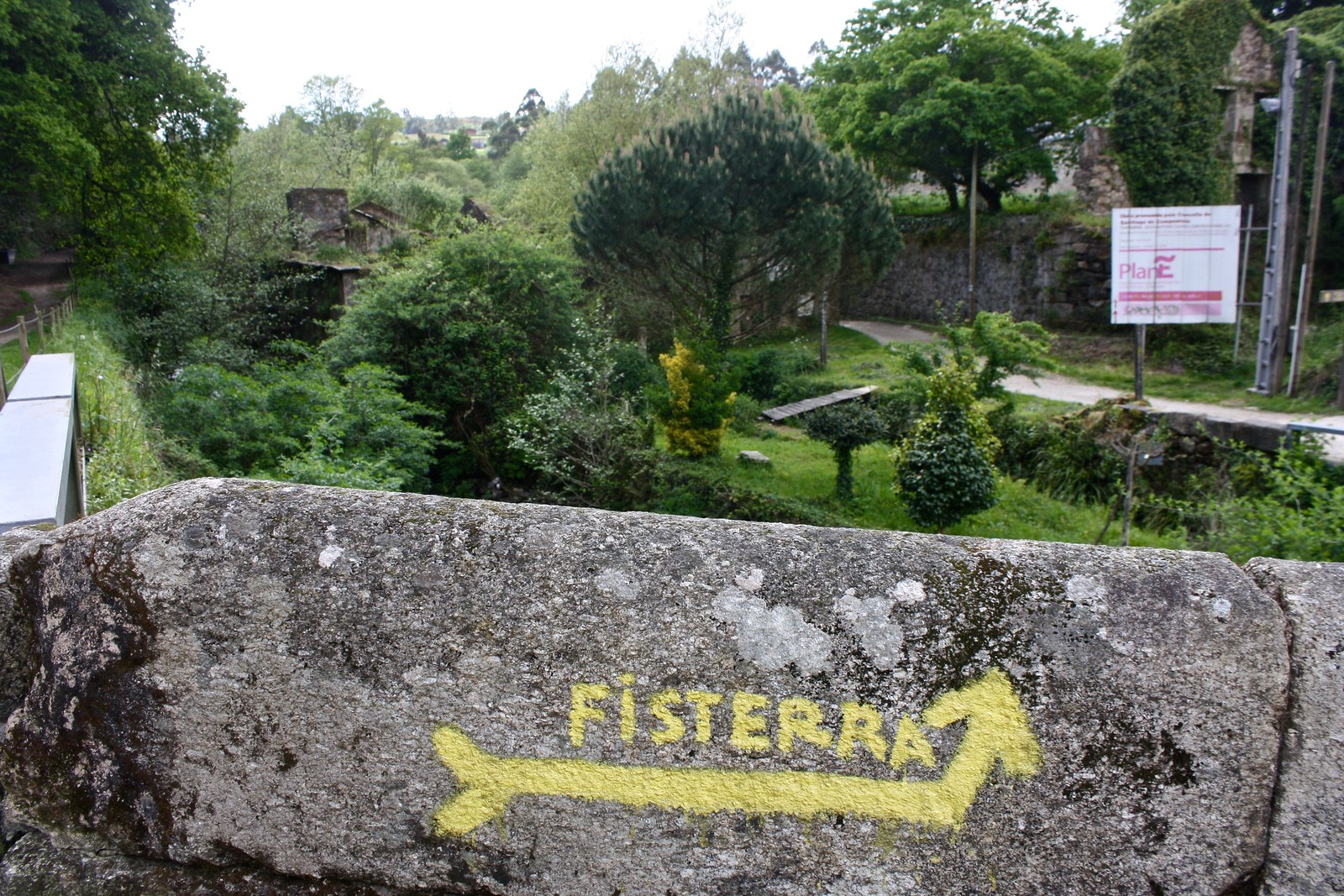 Yellow arrow for the pilgrimage to Fisterra, Spain