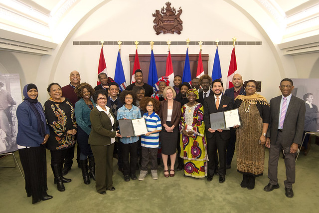 Premier Rachel Notley, Minister Ricardo Miranda, MLA David Shepherd and representatives from Alberta's African and Caribbean communities