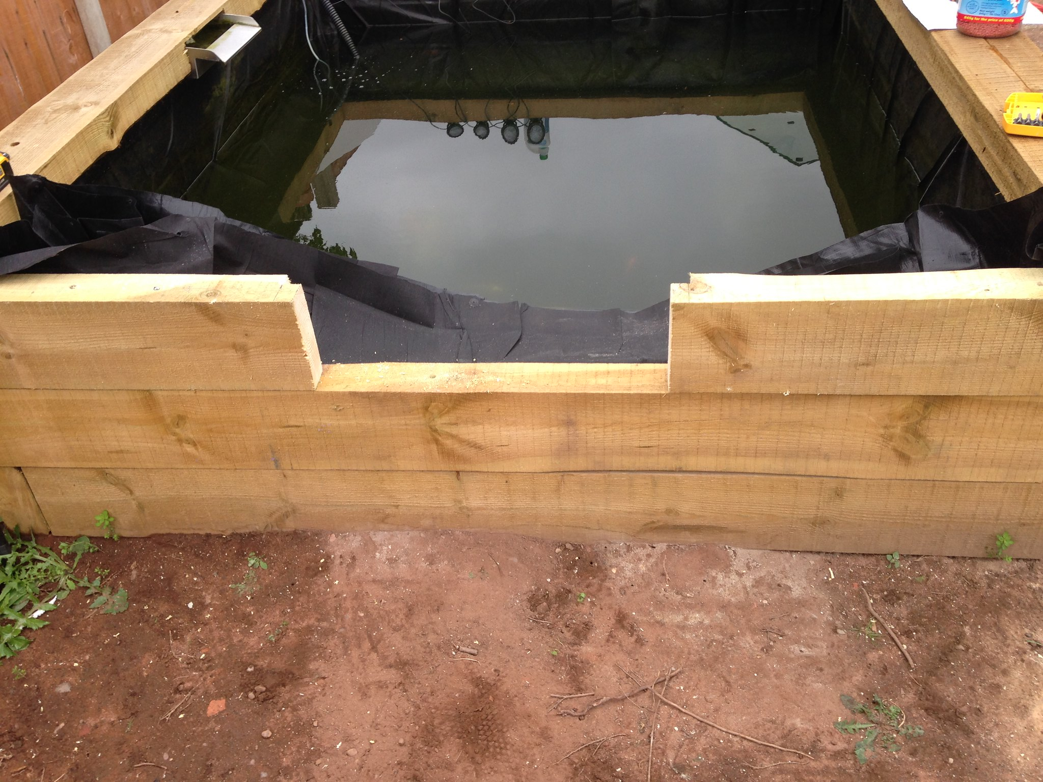 Diy glass pond window with liner pond design and for Wooden koi pond construction