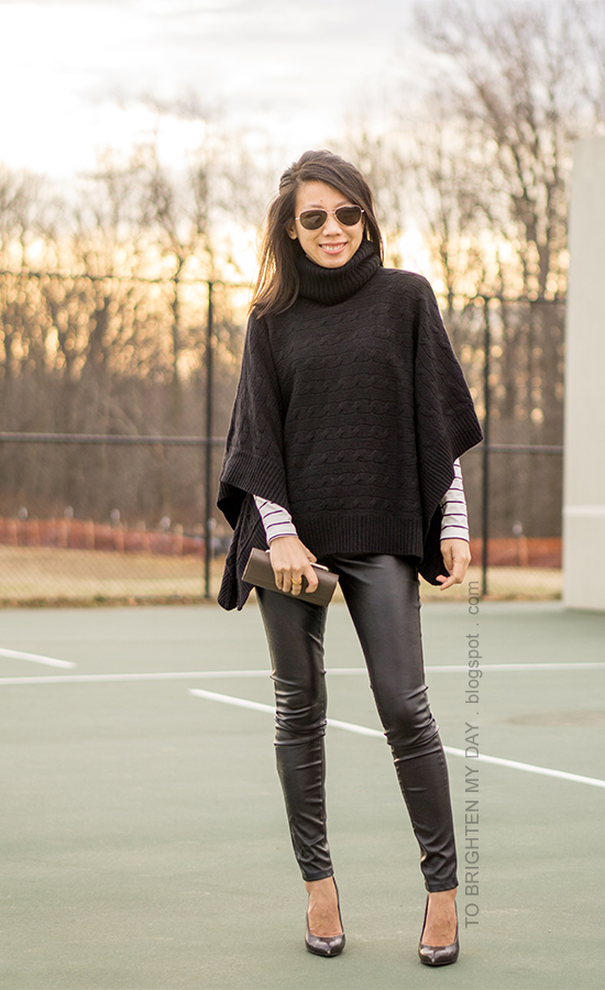 black turtleneck poncho, striped top, black faux leather pants, taupe clutch, black croc embossed pumps with wooden heels