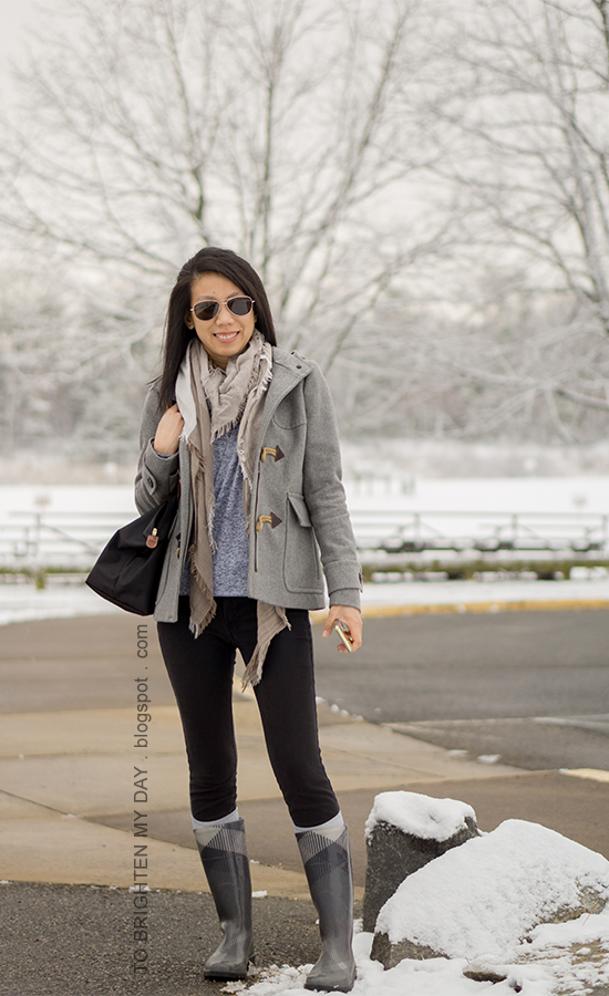 plaid scarf, gray duffle coat with toggles, gray front-wrap fleece hoodie top, black skinny jeans, socks, plaid rain boots