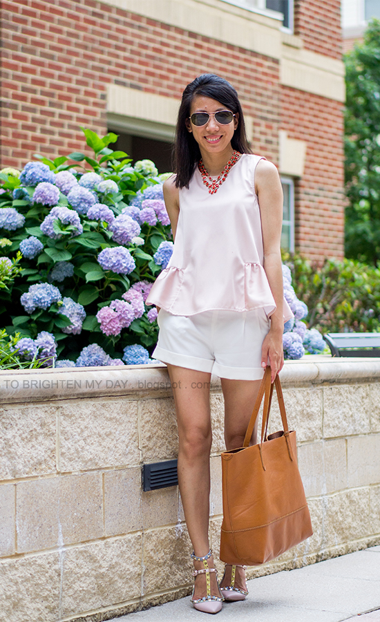 coral necklace, light pink peplum top, white shorts, watercolor stud flats