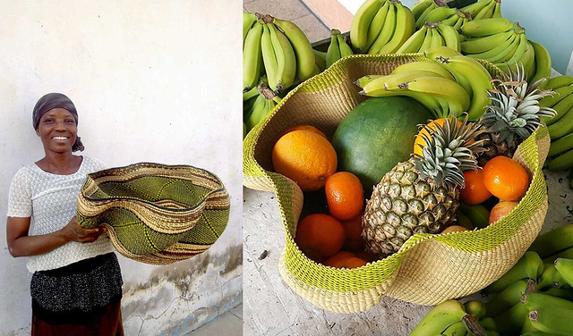 The weaver poses with a handwoven fruit basket at Baba Tree Basket Company