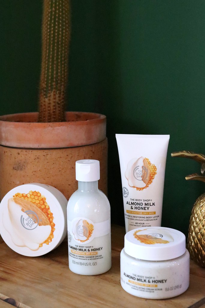 the body shop, the body shop review, the body shop almond milk and honey, the body shop among milk and honey review, the best body creams for winter, body creams for acne, body scrubs to combat pimples, bedside beauty, combat ageing skin