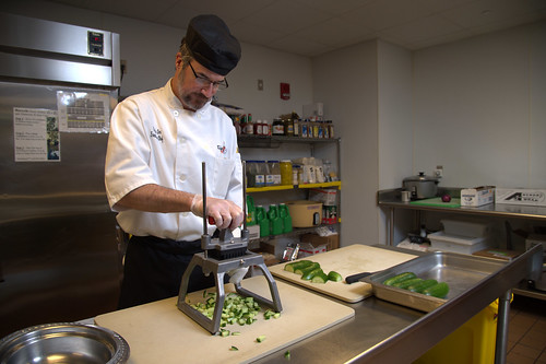Executive chef Chris Cox dices cucumbers from the aquaponics project to serve in meals at the Student Center.
