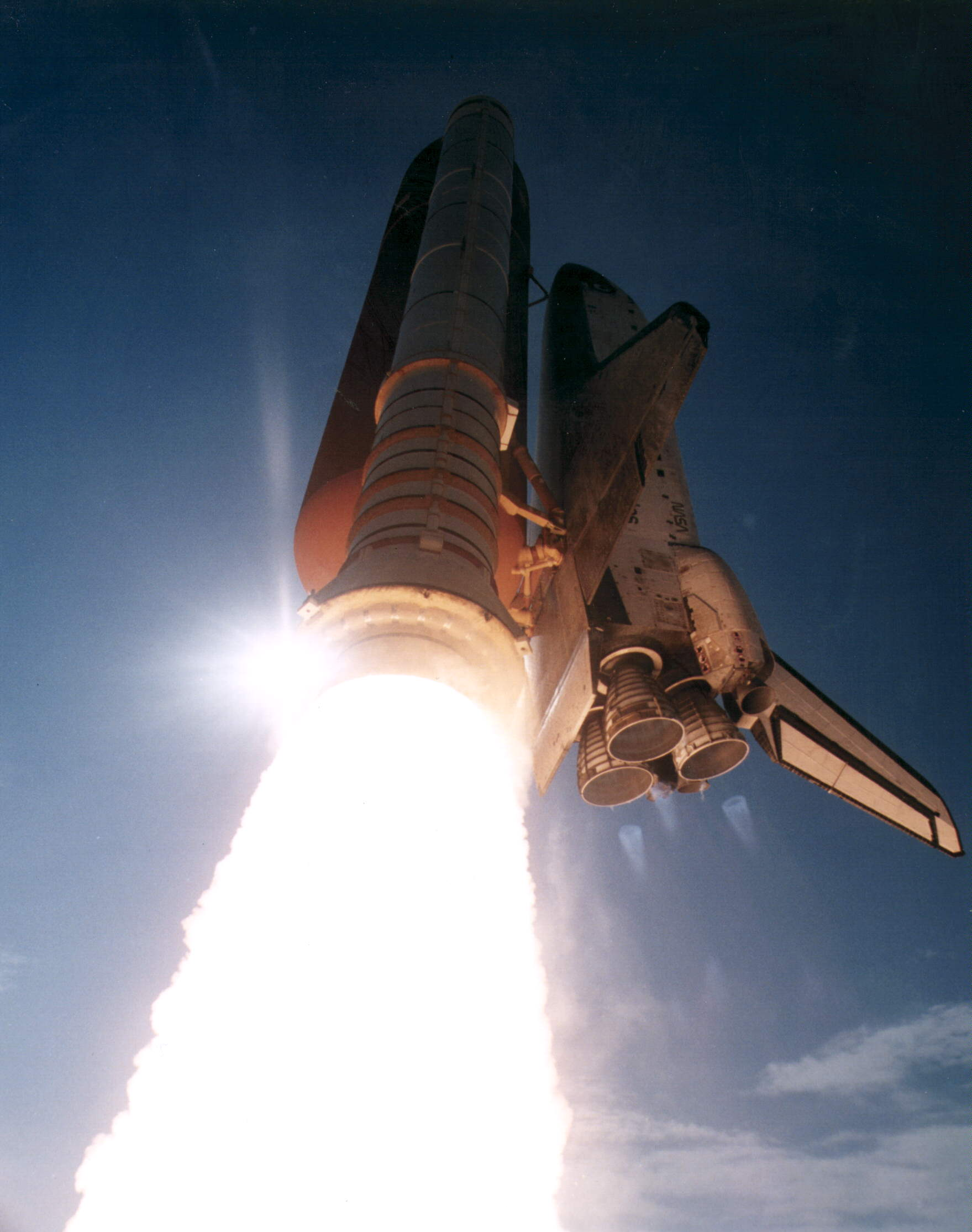 Space Shuttle Discovery's STS-70 mission launched on July 13, 1995 from Kennedy Space Center. STS-70 was the last of seven shuttle missions to carry a Tracking and Data Relay Satellite a tool used by NASA to communicate with other satellites, balloons, aircraft, and the ISS. [1759 x 2229]