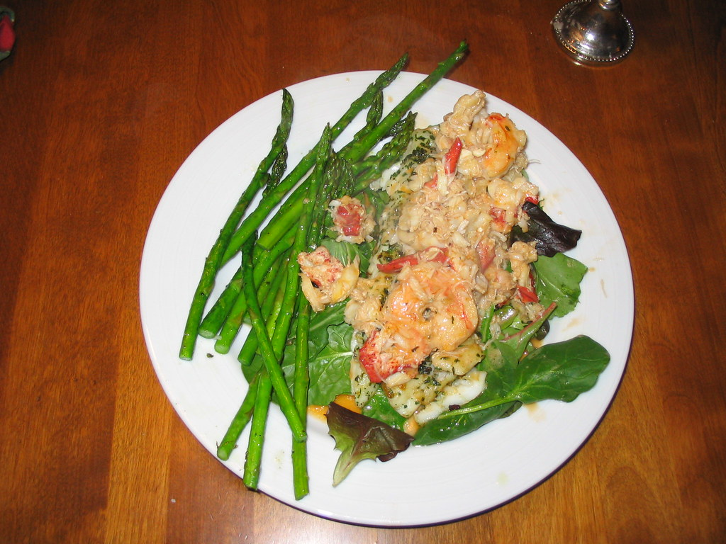Pan seared boston cod fish with crab and lobster brandy cr for Crab topping for fish