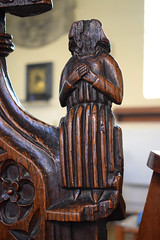 bench end: seated robed figure (15th Century)