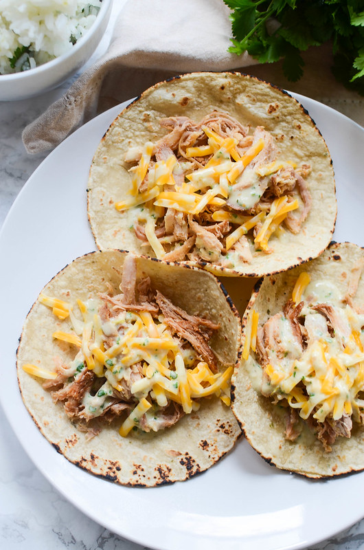 Slow Cooker Sweet Pork Tacos with Cilantro Ranch Dressing - crockpot shredded pork cooked in a sweet and spicy sauce. Use it to make tacos or burrito bowls and top with homemade Cilantro Ranch Dressing!